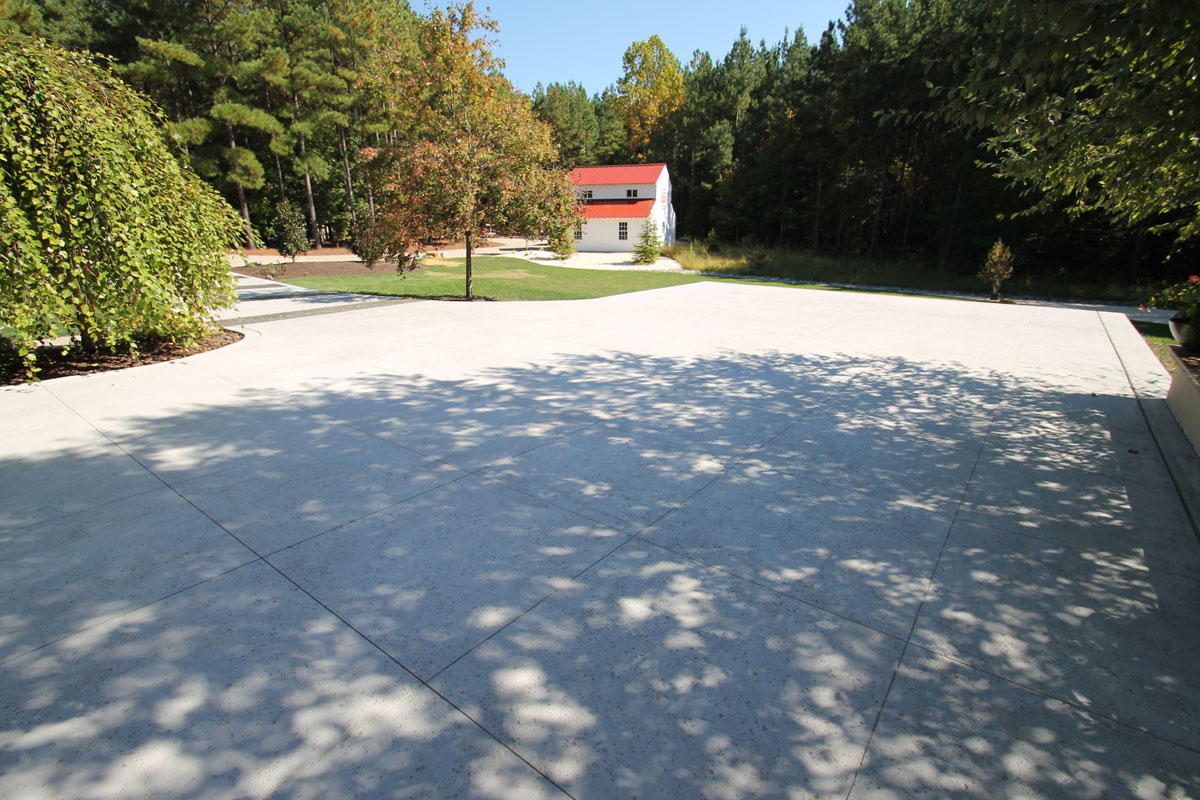 Cantilevered Stamped & Textured Concrete Driveway by ConcreteVA.com